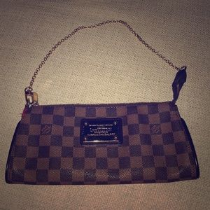 Authentic Louis Vuitton Eva Clutch